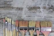 Set of paintbrushes in a wood background
